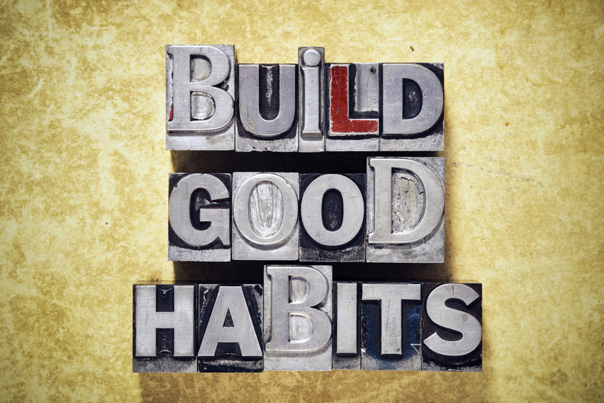 Build Good Habits Phrase Made From Metallic Letterpress Type On Grunge Cardboard Background