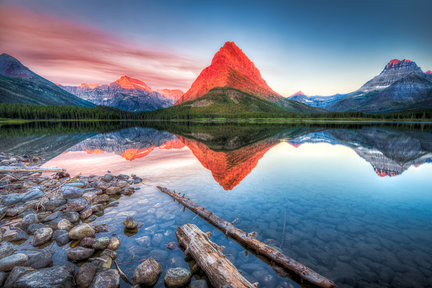 Stunning Reflections On Swiftcurrent Lake In Northern Montana At Sunrise